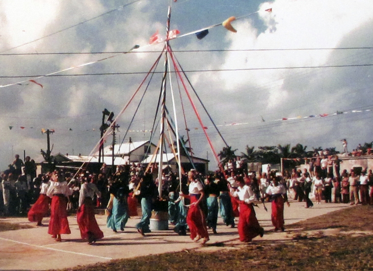 "Green Turtle Cay residents ""Plait the Maypole"", an old English tradition, at the first Island Roots Heritage Festival, 1977"