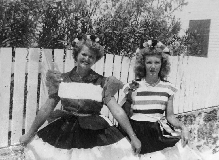 Green Turtle Cay's Iva Lowe (at right) and Alice Gates, in dresses they made specially for Coronation Day festivities.